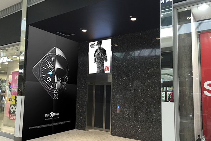 Advertising on lifts entrance in a mall